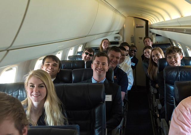 Auburn students are pictured in the cabin of an American Eagle jet.