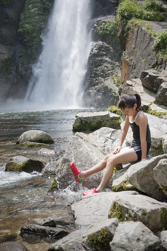 Little girl enjoying waterfall in forest in Sendai, Japan