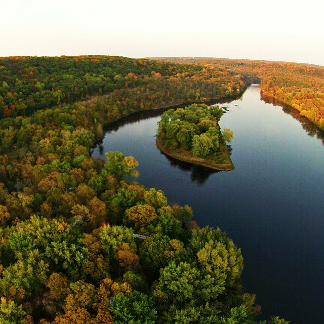 Dusk along St. Croix River. Taylors Falls, Minnesota.    That little island is named Folsom Island. 10,000 years ago, glacial torrents carved the St. Croix Valley leaving the hard basalt floor that forms the gorge today. Our honorary residency as Minnesot
