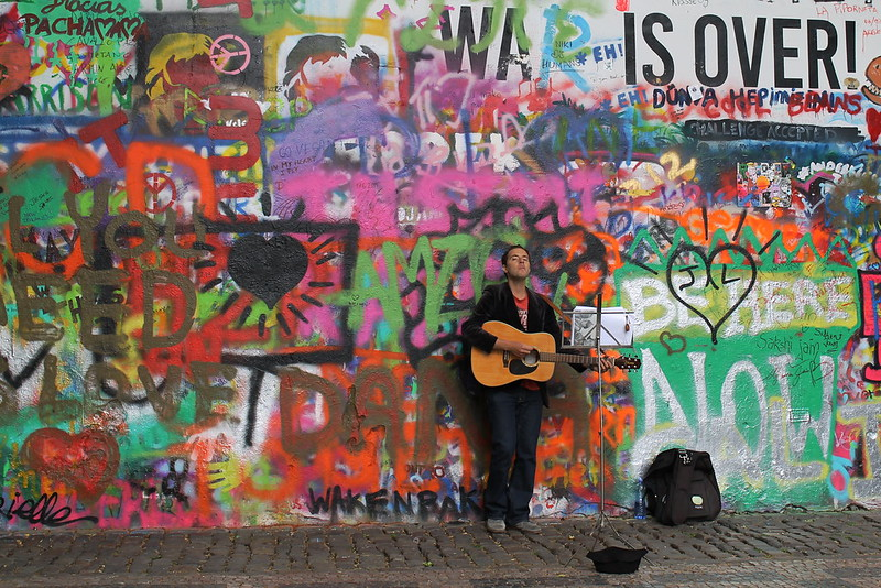 Singing classics from the Beatles in front of the John Lennon Wall