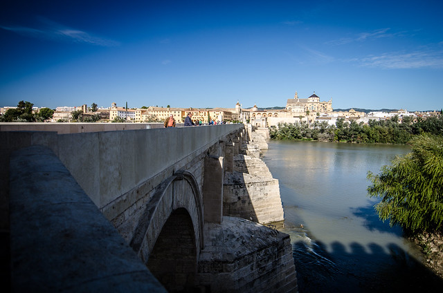 A view over the Roman Bridge looking towards the historic center of Córdoba, Spain.