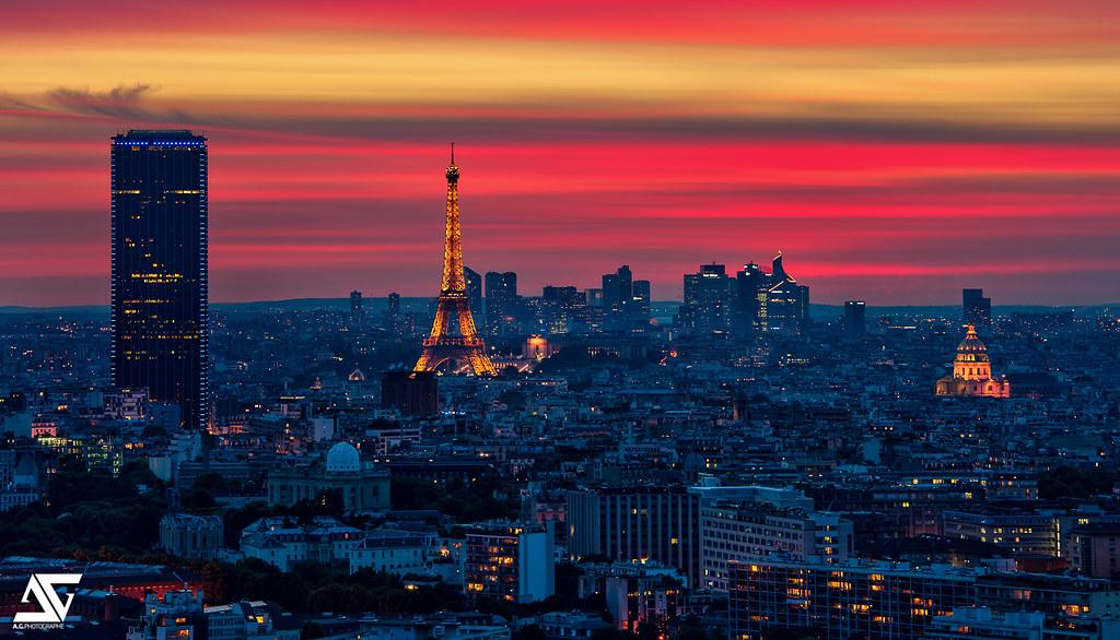 Red sunset tour eiffel la d fense tour montparnasse et l flickr for Photographe la defense