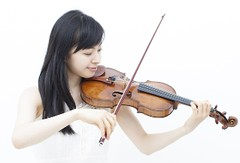 Photo of violinist practicing