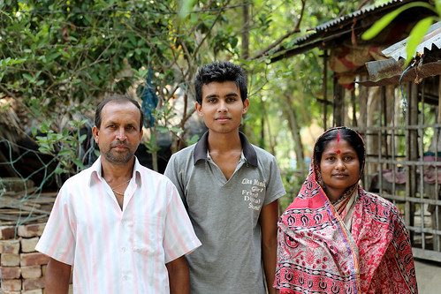 Komola Roy with her husband and son outside their home in Khulna, Bangladesh. Photo by M. Yousuf Tushar.