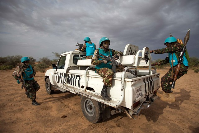 July 2014, troops from Tanzania, deployed in Khor Abeche, South Darfur, conduct a routine patrol in Karbab village, where the community reported threats by other tribes.