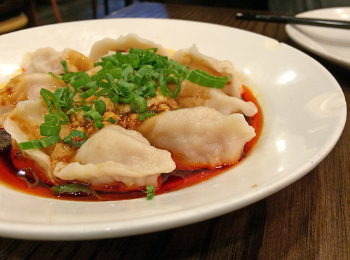 Water dumplings with spicy sauce