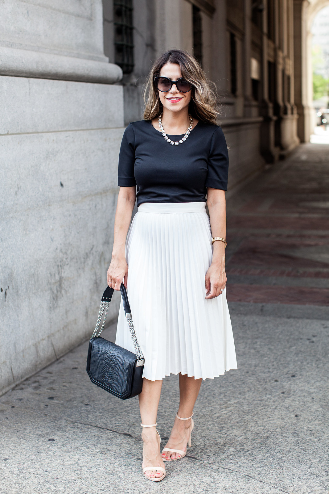 Of course, pleated skirts are not for everyday wear, as they are eye-catchy and sophisticated. You should wear something that will not draw attention from your bottom, let it be a simple chambray shirt, comfy solid neutral color sweater, khaki or denim jacket, pastel color simple tops, or classy coats.