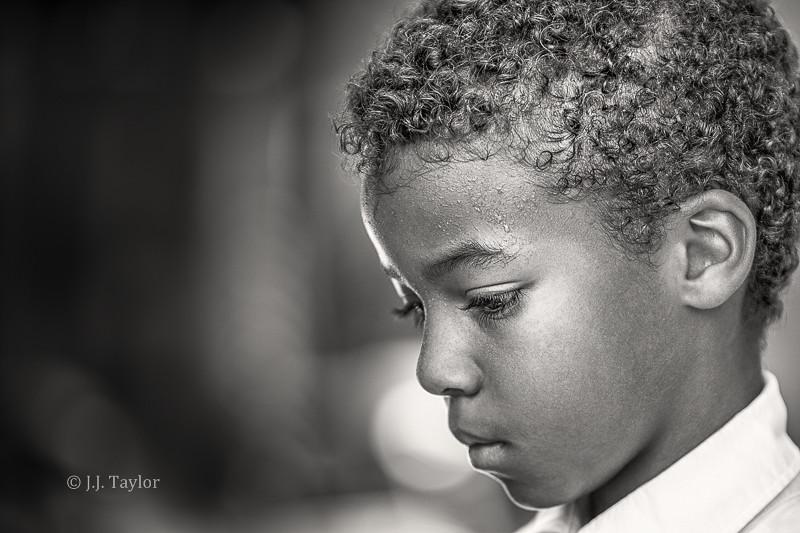 portrait black and white profile portrait of boy looking