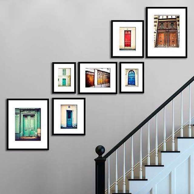 Hanging art on your wall going up the stairs can be challe for Hanging pictures on wall