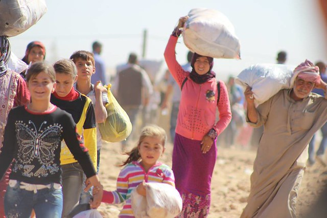 Massive influx of Syrian Kurdish refugees into Turkey