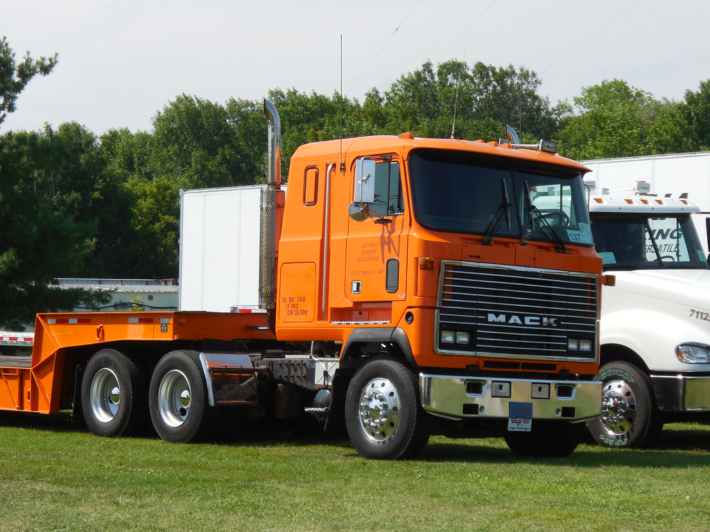 cabover mack mh | An orange cabover Mack MH flatbed at the ...