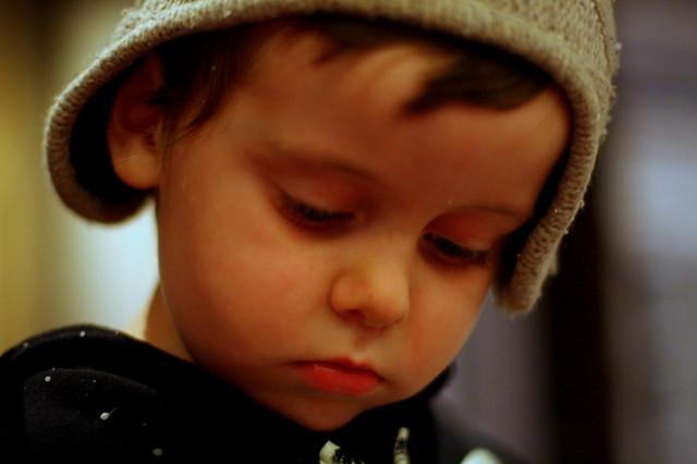 Sad Little Boy Concentrating
