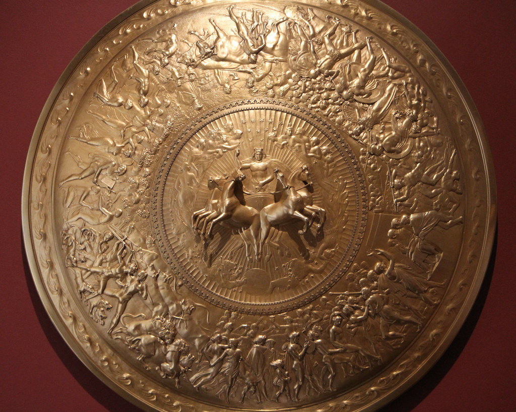 shield of achilles The shield of achilles is described in one of the most famous passages of homer's iliad, and is rich in symbolism and detailed imagery this lesson.