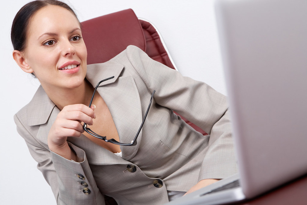 Woman at work | Portrait of a successful businesswoman looki ... Woman