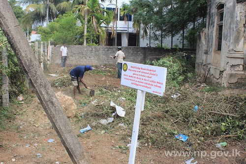 JMC clears unmaintained lands to mark Dengue Week – 13 September 2014