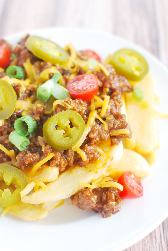 Sloppy Joe Fries - fries topped with sloppy joe meat, melted cheese, green onions, grape tomatoes, and jalapenos! Perfect football food!