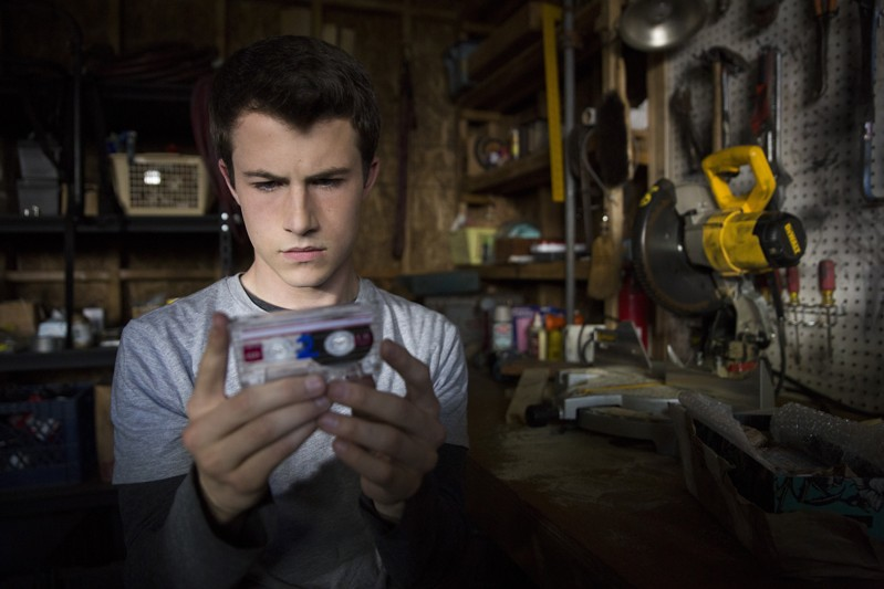 13 Reasons actor Dylan Minnette looking at a tape