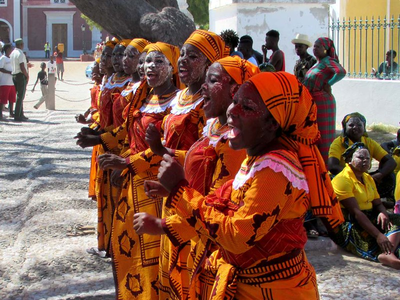 A row of local dancers greets cruise ship passengers arriving on Mozambique Island