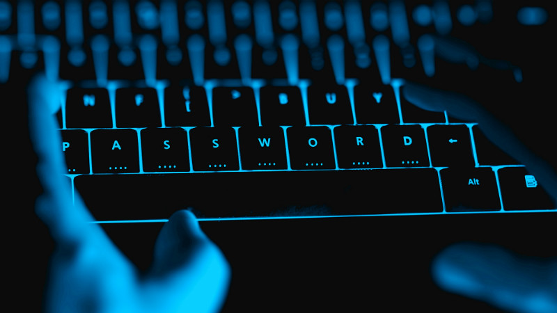 Keyboard and hands in blue light