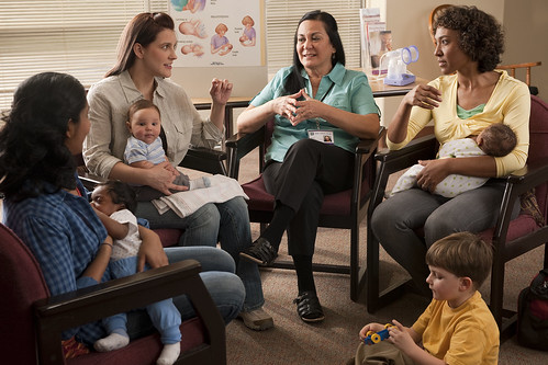 New moms participating in a group discussion with a WIC counselor
