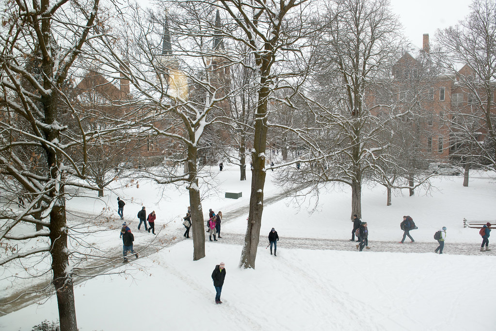 students walk in the snow | Students walk across campus in ...