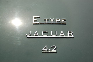 Jaguar E-Type 4.2 at Samuel's in Allston: Model plate on the trunk / boot lid | by Chris Devers