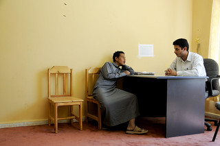 A case worker interviews a young man a shelter for street children | by World Bank Photo Collection