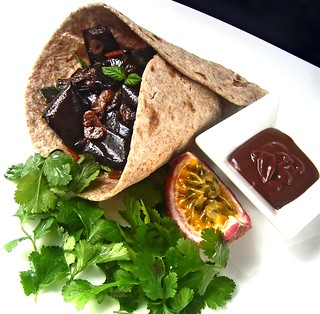 Chapatti wrap of pickled eggplant Sicilian style with fresh mint and coriander leaves served with a maracuja, chocolate, fried onions dip sauce | by RecipeTaster