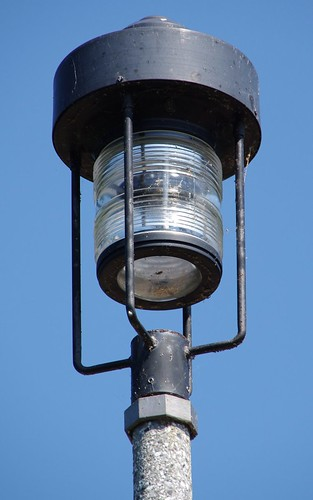 French Light Poles : Concrete light pole this is on a side road near the