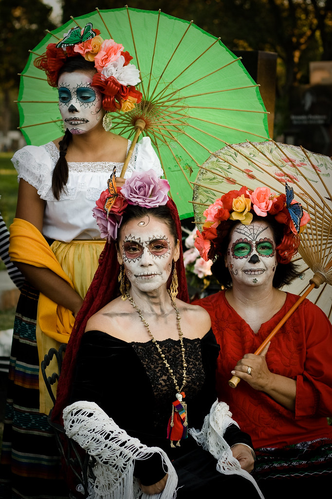 day of the dead costumes women posing in full costume by