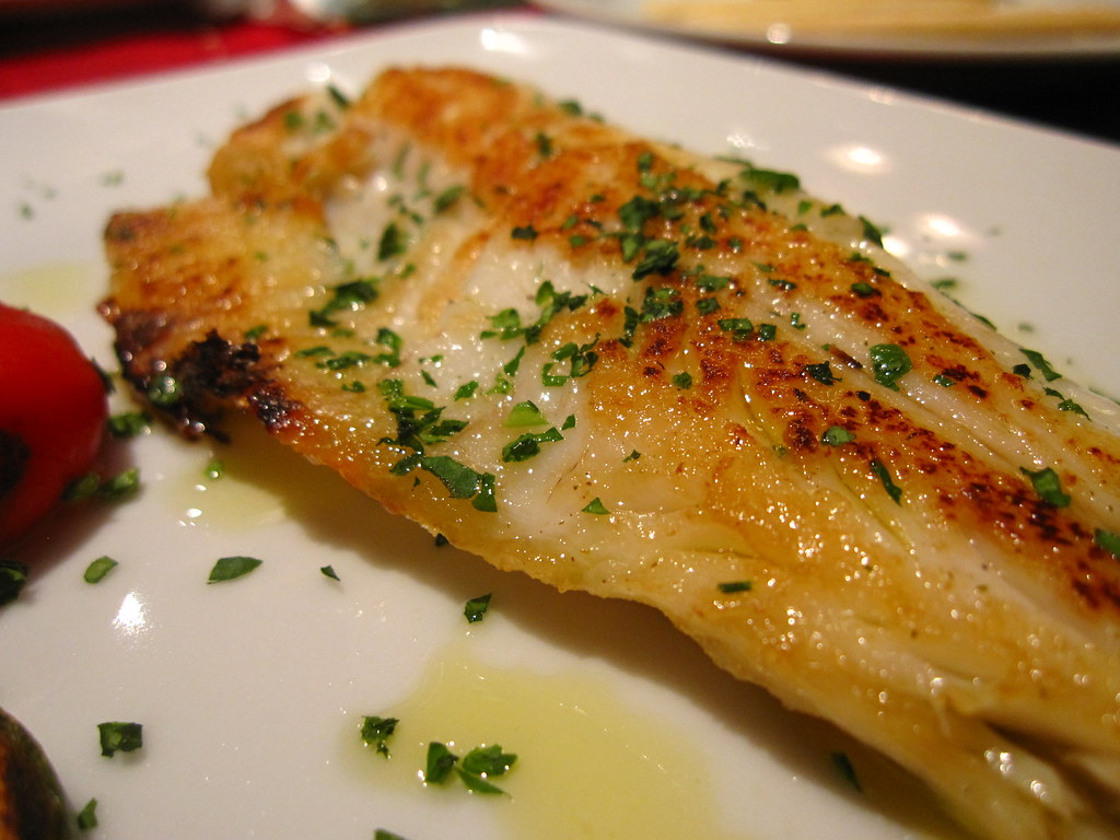 Baked fish in olive oil kate hopkins flickr for Temperature to bake fish