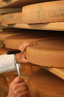 tapping Comté | by David Lebovitz