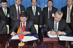 Mr. Fedotov (right) and Mongolian Minister of Justice and Home Affairs Nyamdorj Tsend, sign Joint Statement