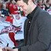 2011 NHL All Star Cam Ward signs autographs for the fans on the red carpet.
