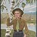 [Speiderjente ved bjørk] / [Girl scout by birch tree]