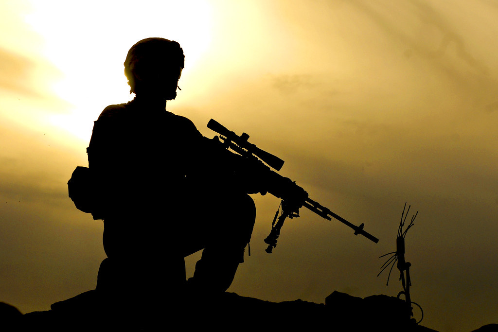 Sunset Security U S Army Pfc Kevin March Kneels Atop A