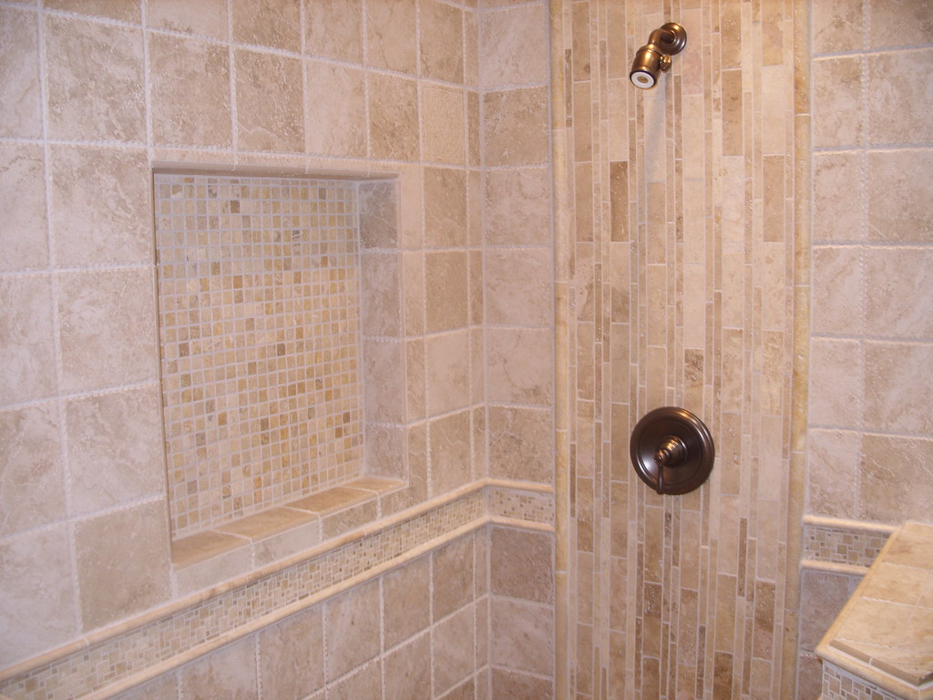 Travertine shower tile design w niche and border matt