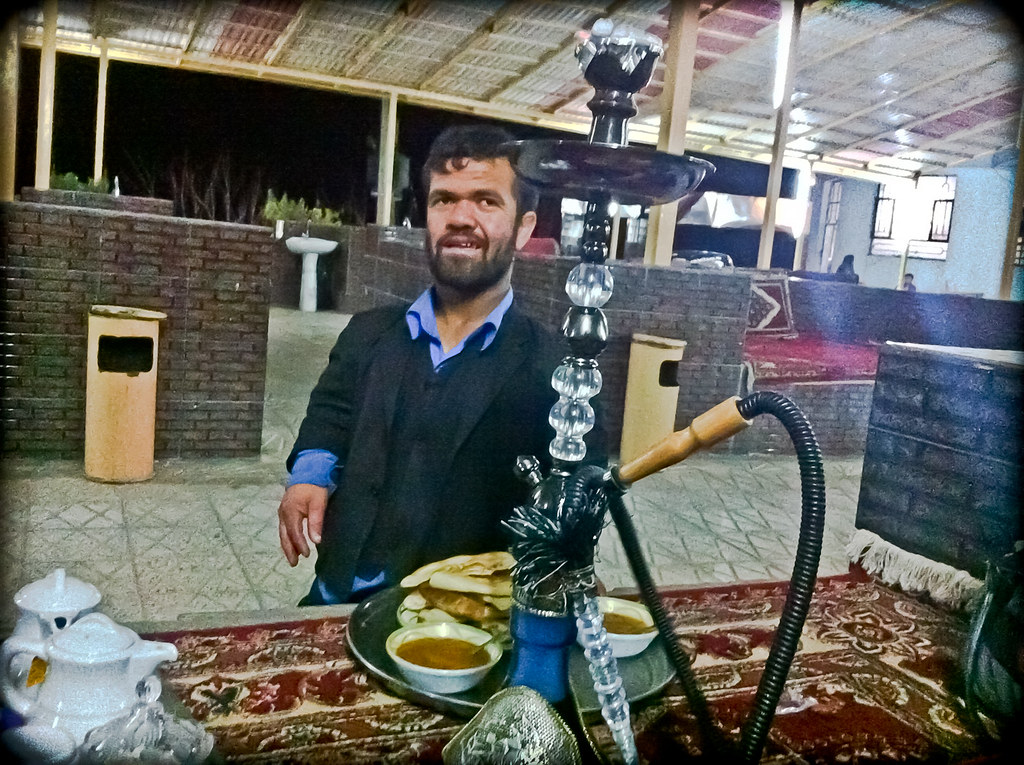 Midget Waiter At 1001 Night Restaurant In Herat He