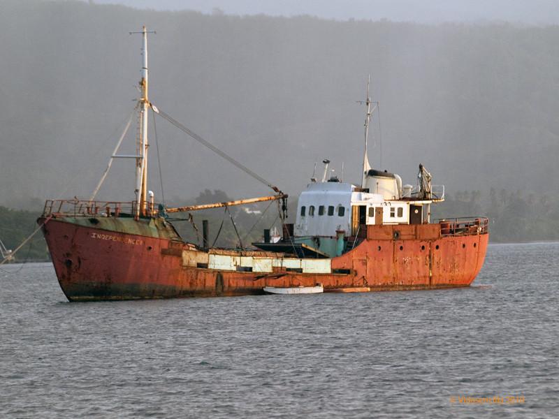 Old cargo ship | A cargo ship lies anchored while being ...