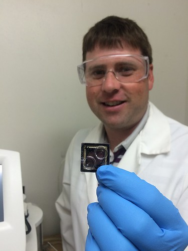 Forest Service Research Botanist Jonathan Palmer holding a DNA sequencing chip