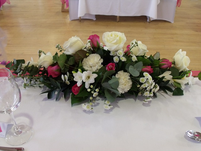 Low and long top table flower arrangement flickr photo