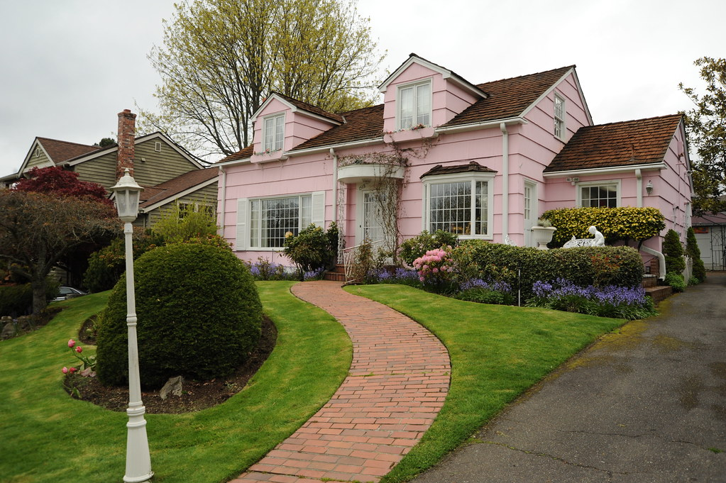 Pink House With Brick Path White Lamp Pole Yard Trees