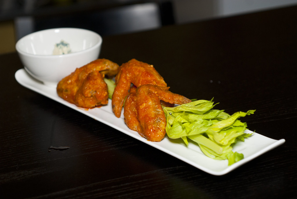 Buffalo Wings and blue cheese dip | wings are breaded and de ...