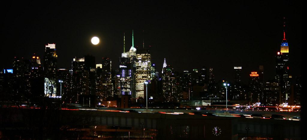 Full Moon Over The New York City Skyline At Night A Full