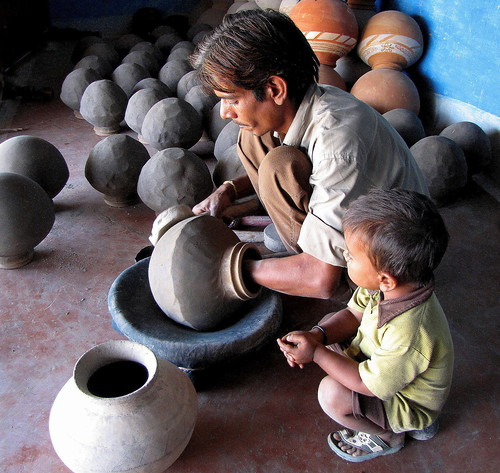 """Shaping an Earthen Pot"" by Doranne Jacobson 