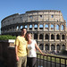 Newlyweds on Honeymoon: Jennifer Boresz, BA '04, with husband Brian Engelking, BSME '03 in front of the Coliseum in Rome, Italy