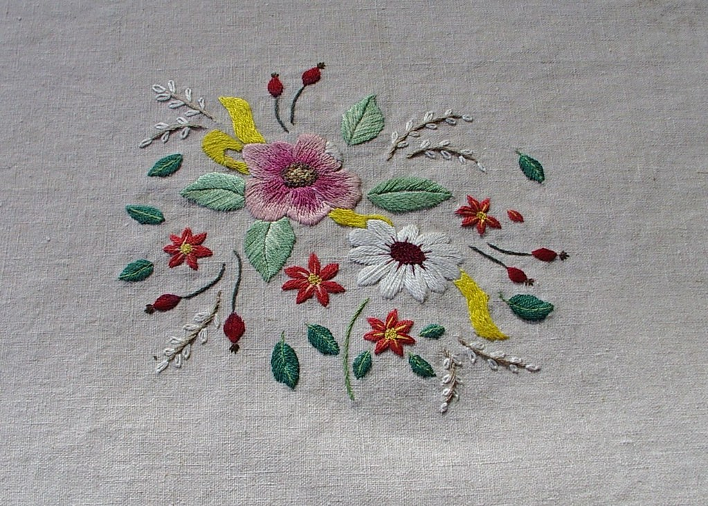 Flowers hand embroidered this embroidery took many hours