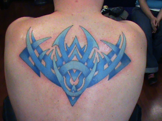 Blue tribal james danger the skin gallery tattoo 916 550 for Skin gallery tattoo