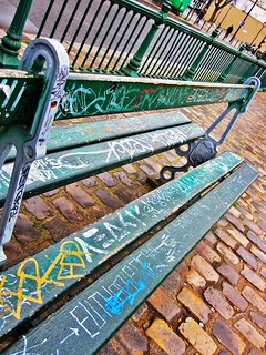 Graffitied bench on Canal path | by alifeintranslation