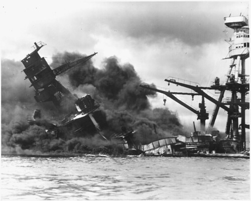 U.S. Navy photograph of battleship Arizona sinking after being hit by Japanese air attack on Dec. 7, 1941. National Archives photo.
